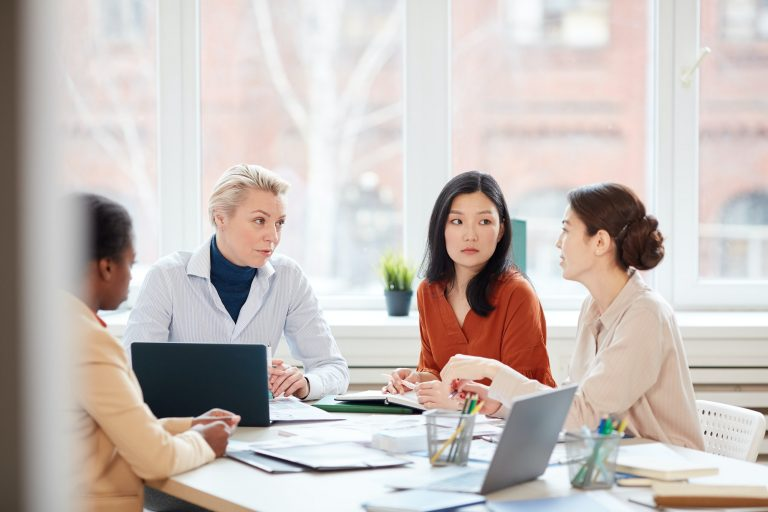 Multi-Ethnic Group of Women Meeting in Office
